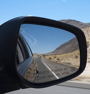 Objects in mirror are closer than they appear (CC BY-SA 2.0) by Luca Sartoni